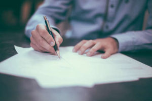 person-signing-document